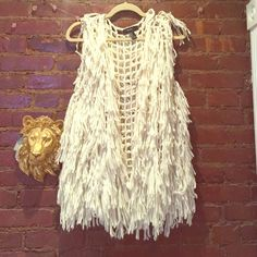 Cream shag vest Shaggy loop hole vest in a beautiful white / cream. Super boho vibe. Soft and comfy!! Worn only once. Is from forever 21 Jackets & Coats Vests