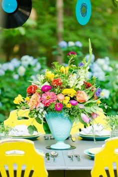 This super colorful centerpiece is completely on point for a wedding with fun, whimsical style!