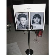 Table numbers by your age (table 9 a picture of when you were 9) cute idea!