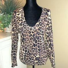 Top by Express Animal print and soft, looking sleeve top. Very comfy and warm. Flattering especially with cleavage. Express Tops Tees - Long Sleeve
