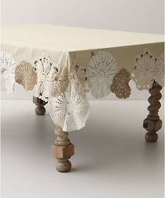 Beautiful doilies reborn as embellishment for an otherwise plain table cloth. You could do this with a red table cloth as well with white doilies for a more festive Christmas approach. Doilies Crafts, Lace Doilies, Crochet Doilies, Crochet Tablecloth, Table Cloth Crochet, Sewing Crafts, Sewing Projects, Diy Projects, Diy Crafts