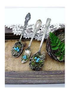spoon ornaments with bird's nests. the sterling silver geek within me loves this idea.