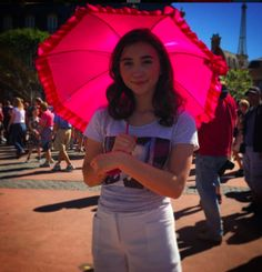 I like the way the shadow of the umbrella falls on her face...
