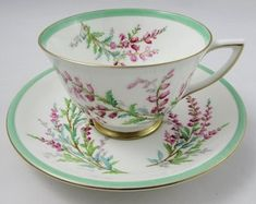 Doulton deco - Bell Heather tea trio, - Floral design with green banded design and gold gilt trim. Green edge variant with pixie-ear shaped handle and deco square side plate. Vintage Dishes, Vintage Tea, Cup And Saucer Set, Tea Cup Saucer, Teapots And Cups, Teacups, Antique Tea Cups, Cuppa Tea, China Tea Cups