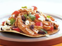 Serve tostadas made with Old El Paso® black beans and chicken topped with cheese and tomato - Mexican dinner ready in 20 minutes.