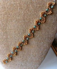I made Sandra Halpenny's Dime Store Bracelet, which was featured on Linda's blog a few days ago. I used 6lb. Crystal Fireline and the lace was fairly stiff.