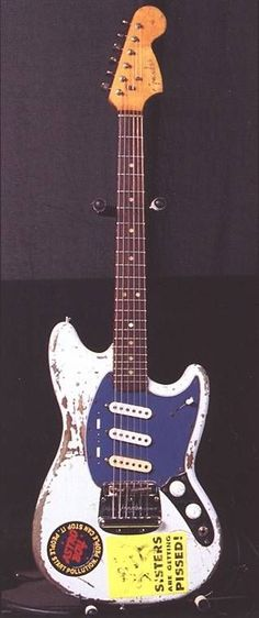 This instrument was part of Sonic Youth's arsenal but it got stolen in a big theft in 1999. It's a modified/frankestein Fender Mustang assembled from various parts. More info: http://www.sonicyouth.com/mustang/eq/gtr18.html  See it live! http://youtu.be/_XFmxzCyJGg