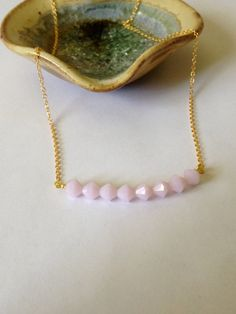 Handmade Gold Necklace with Opaque Light Pink Beads by DinxDesigns, $16.00