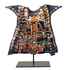 Turkish Childs Ceremonial Garment  Turkey  20th Century  A Turkish Childs hand woven robe that is adorned with beads and hammered tin plates and displayed on museum quality stand.