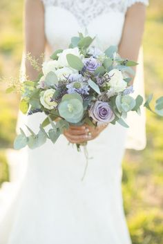 flowers by Jennifer Pinder wedding florist Kent London bouquet in purple and white in a wild flower style. Purple and white roses, scabious, lavender, limonium and eucalytus xx
