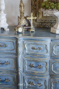 French Provincial dresser with Chalk Paint® | Base coat of Aubusson Blue then layered colors of Provence, Duck Egg Blue, French Linen and Paris Gray. Finished with Annie Sloan Clear and Dark Wax. Incredible project by Edith and Evelyn Vintage.