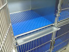 Heavy duty steel cages with elevated, perforated flooring, allowing urine to drain into the pull out collection pan and a divider to utilize space efficiently. Direct Animal's dog kennel panels, runs, floors and other premium dog kennel designs can be customized for your style and function standards in any space