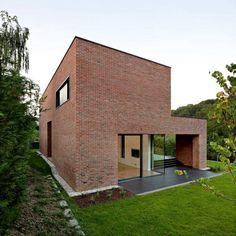 Impressive Brick Monolithic Home with Minimalist Interiors: Podfuscak Residence
