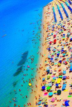 beach + umbrellas. I love all the fun colors!