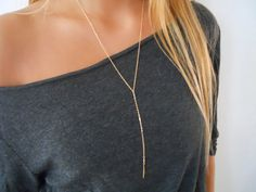 Minimalist and elegant long gold necklace. Perfect to wear on its own or to layer with more necklaces  Materials: 14K Gold filled chain 14K Gold filled beads Gold spike - 2 micron gold plated (extremely high quality material)  Length: ♦ Please pick your desired length at checkout. ♦The length in the menu refers to the necklace without the drop chain part. ♦ The drop chain part is 5 (including the spike pendant at the end) ♦ The necklace has a 2 adjustable chain at the end. So it gives you a…