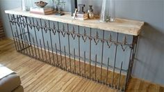 Creative Uses for Old Salvaged Fencing: wrought iron fence and barn wood table