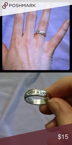 """Sterling silver """"God is love"""" ring Size 7. Has seen many years of love, but still a beautiful ring. Originally came with black paint(?) in the letters, but that came out long ago. Stamped 925 on the inside and has been freshly polished. Jewelry Rings"""