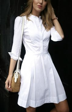 white cotton sheath knee length dress with tuxedo collar and pleats, woven straw summer bag, white loafers with black and white grosgrain ribbon strip, black and white striped umbrella // j. crew, goop label by gwyneth paltrow, rag & bone