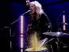 Ellie Goulding playing glitter-topped drums
