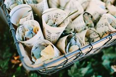 Cones (like these made from music sheets) are a pretty way to display petals or confetti for guests to toss...