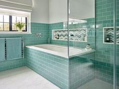 bathroom with turquoise subway tile