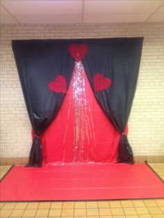 Backdrop for a middle school Valentines dance. Made with Dollar store tablecloths and decorations.