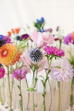 Single stems in separate bud vases
