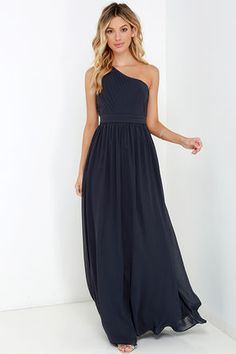 Saunter on by in the Painted Words Dark Blue Grey One Shoulder Maxi Dress and watch as heads turn! Fine pleated details form a one shoulder bodice with lightly padded cups and a unique cutout back detail. Long, flowy maxi skirt made of Georgette fabric descends from the banded high waist, completing this elegant number! Hidden side zipper and clasp. Fully lined. Self: 100% Polyester. Lining: 95% Polyester, 5% Spandex. Dry Clean Only. Imported.