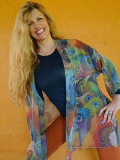 Soft and flowy, 100% washable silk, mosaic style rainbow of birds design. Looks great with all color combos.