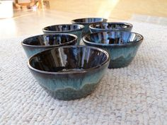 "Set of Stoneware cereal bowls by Shelley Duncan, glazed in ""Coffee Brown"" with rim dipped in ""Mottled Teal"""