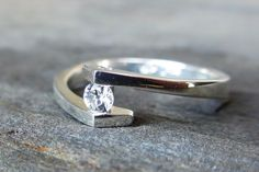 Sterling Silver and White Sapphire Engagement ring Size 6,7,8. $430.00, via Etsy.