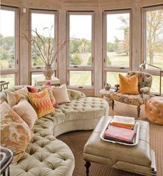 Pale green, the curved & tufted sectional & the bowed bank of windows...  perfection!