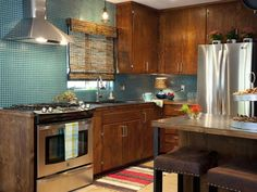 """Steel countertops - beautiful.   """"Property Brothers: This kitchen has an urban rustic vibe."""""""