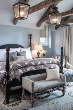 Bedroom wall color is Alaskan Skies from Benjamin Moore. Norman Design Group. Bedroom paint color ideas.