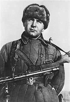 Krasnodar Territory, Soviet Union. Soviet Naval Infantry Major Caesar Kunikov poses for a photo with a Soviet PPSh-41 submachine gun near Novorossiysk. Kunikov was posthumously awarded a Hero of the Soviet Union for bravery and courage in a military operation of the Soviet Navy to liberate Novorossiysk from the German forces in 1943 during the Second World War. TASS - pin by Paolo Marzioli