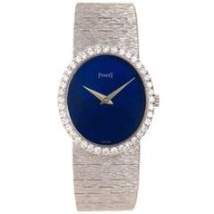 View this item and discover similar for sale at - Circa 1980 Piaget ladies White Gold wrist watch, measuring 1 x inch, original factory bezel containing 1 Carat of fine white, round brilliant cut Elegant Watches, Stylish Watches, Beautiful Watches, High Jewelry, Modern Jewelry, Ring Watch, White Gold Diamonds, Fashion Watches, Jewelery