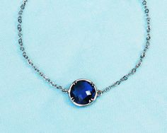 Framed and faceted Necklace  with bezel set aqua by GojoDesign, $23.00