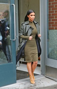 And strut! Kim Kardashian turned the sidewalk into her catwalk as she strode out of her NYC apartment on Wednesday in a stunning green dress