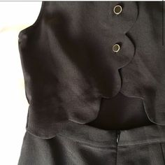 ‼️‼️ SALE! NWOT Black romper Never before worn, super cute black romper! The cut is so incredibly cute with buttons down the top of the back and a cut out mid back. *first picture is not mine! Taken from website! Dresses