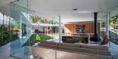 A Home with Glass Walls and a Central Courtyard in Brazil
