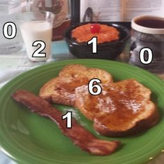 whole wheat French toast. I topped it with a sift of confectioner's sugar and 2 teaspoons of my fave syrup.  Go-withs included hickory smoked bacon, cripsy, 1 slice, all-natural milk, broiled grapefruit with a cherry, water, and black coffee