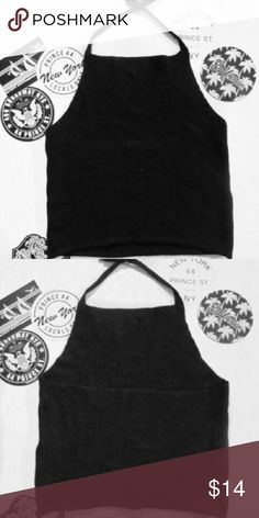 Brandy Melville Black Alyssa Halter this adorable brandy top has never been worn but does not come with tags!  it is a black knit fabric with easy ties to tie behind you neck halter-style.  please feel free to comment any questions below as prices are negotiable. (all brandy melville purchases come with stickers) 🖤 Brandy Melville Tops Tank Tops