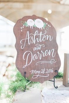 Beautiful wooden sign with hand lettering. View the full wedding here: http://thedailywedding.com/2016/07/31/romantic-rustic-wedding-ashton-darren/