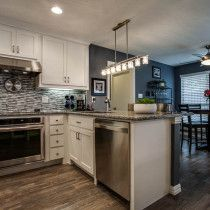 new caledonia granite countertop modern kitchen tile backsplash wood flooring… Modern Kitchen Tiles, Kitchen In, Granite Kitchen, Kitchen Countertops, Kitchen Ideas, Kitchen Colors, Bathroom Cost, Budget Bathroom Remodel, Kitchen Remodel