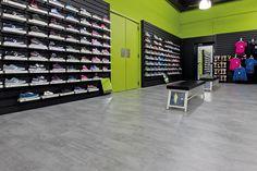Heist-Op-Den-Berg, Belgium, Go Sport retail store Enter Concrete Medium Gray, a class 34 Pergo laminate floor that matches all of these criteria and more. #Store #Shop #Retail #Sport #Flooring #Pergo