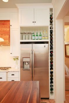 25 Ways To Update Your Kitchen From Pinterest | StyleCaster - What a clever use of that space next to the fridge that always traps dust bunnies!