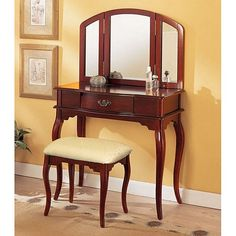 This 3-piece vanity set is a great addition to your bedroom or bathroom to create personal space. This vanity set features cherry finish, table with drawer, tri-folding mirror and coordinating stool.