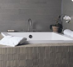 Deep baths with lots of storage space for books, glasses of wine, a neck roll....