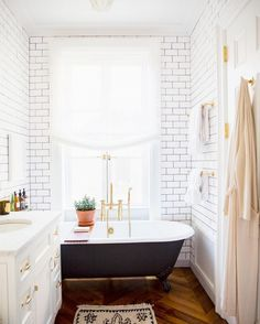 A clawfoot tub adds vintage character to any bathroom.