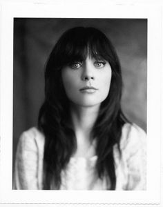 Zooey Deschanel has some unbelievable beauty.  I wish I had hair & skin like hers, and was able to get my eye make up to be this subtle too.